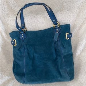 Teal blue suede coach purse with gold accents